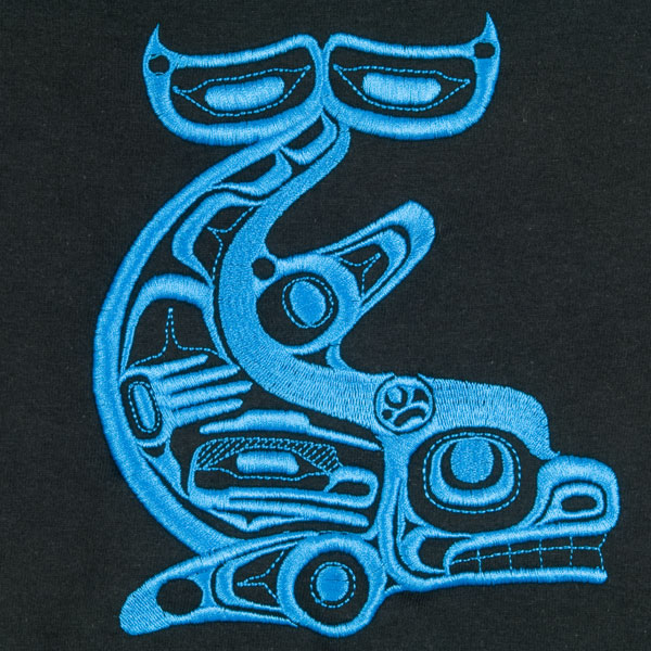The Killer Whale, designed by Yukie Adams, is embroidered in blue on the black shirt.