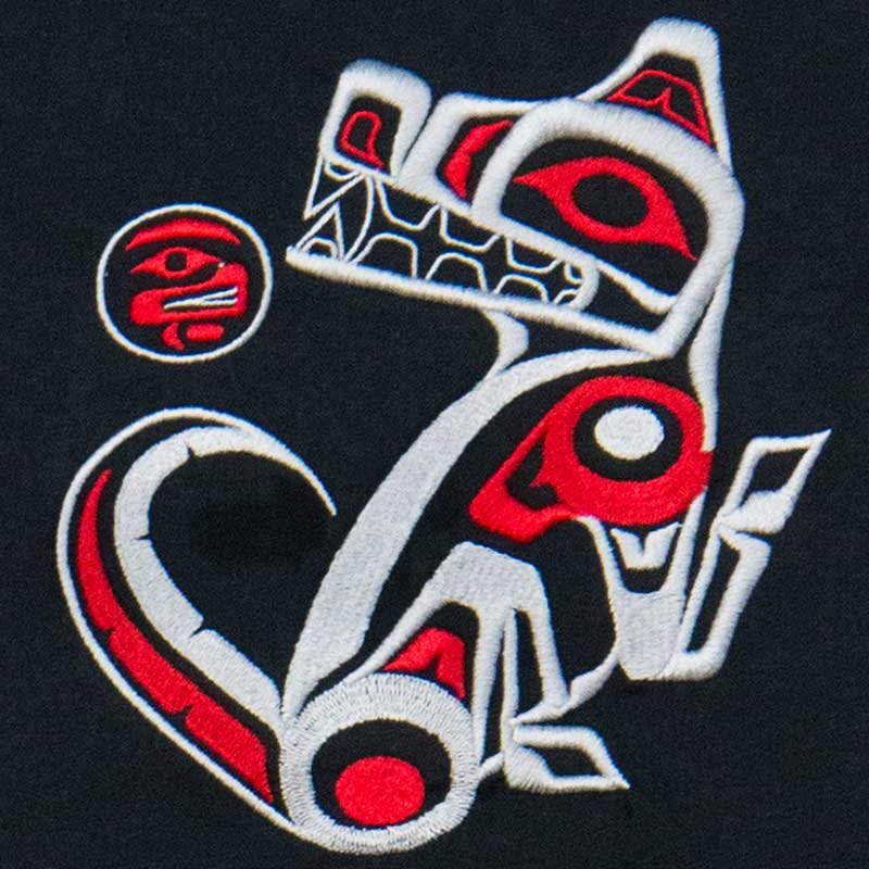 The wolf, designed by Errol Hillis, is shown embroidered in gray and red on the gray T-shirt.