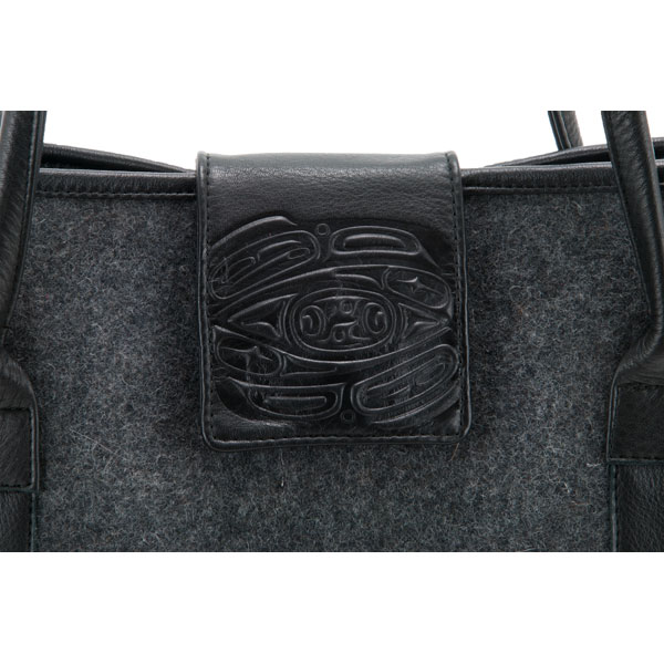 Wool Tote : An eagle-embossed leather flap holds the bag closed with a magnetic snap.