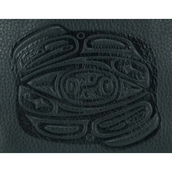 The bovine leather pouch is embossed with Corrine Hunt's own raven design.