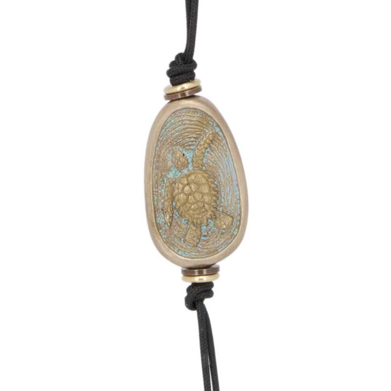 Sea Turtle Amulet Zipper Pull : The amulet features a sea turtle.