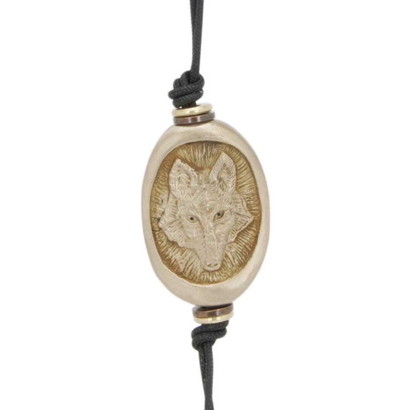 Wolf Amulet Zipper Pull : The reverse side features the wolf's pawprints.
