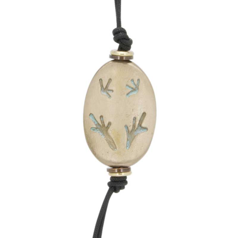 Tree Frog Amulet Zipper Pull : The amulet features a tree frog poised on a branch.