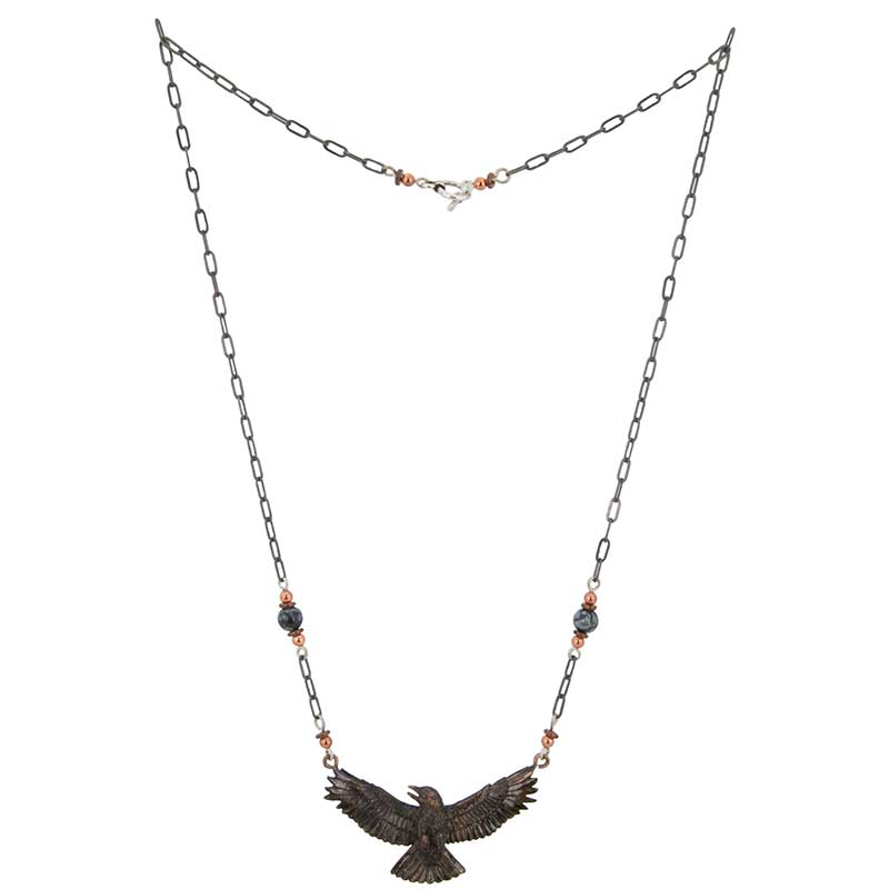 Copper, heishi and snowflake obsidian beads decorate the 20 inch antiqued silver chain of the Crow Necklace.