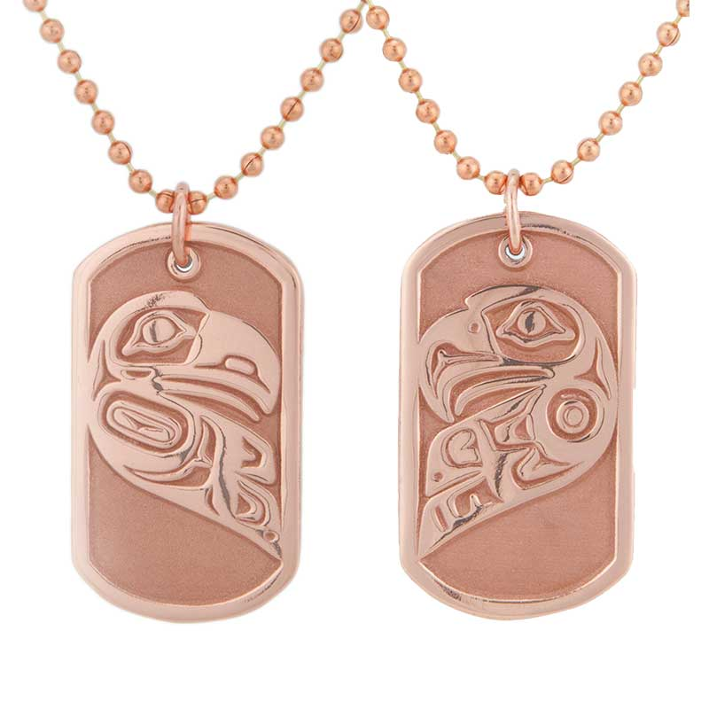 The pair of dog tags display the lovebirds, Eagle and Raven, within a heart shape in this sophisticated design by Odin Lonning.